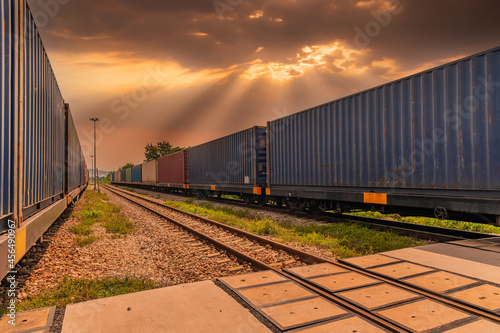 Fototapeta Train with container cargo boxes at railway station transport logistic distribution goods is industry transportion business concept