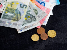 In This Photo Illustration, A Collection Of Various Euro Banknotes And Coins Are Seen Displayed.