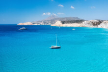 An Aerial View Of The Yacht On The Azure Sea. Transparent Clear Water In The Mediterranean Sea. Summer Vacations And Travels On A Sailing Yacht. Summer Relaxation.