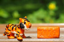 A Tiger Figurine Made Of Plasticine. Next To The Number 2022.