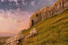Attermire Scar And Attermire Cave Above Settle On The Dales Highway And Pennine Bridleway In The Yorkshire Dales, Shot At Sunset In Landscape With The Sun Catching The Top Of The Cliffs