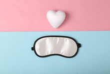 Sweet Dreams Concept. Sleeping Mask And Heart On Pink Blue Background. Top View. Minimal Style