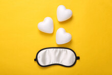 Sweet Dreams Concept. Sleeping Mask And Hearts On Yellow Background. Top View. Minimal Style