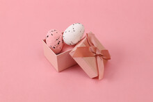 Easter Eggs In A Gift Box On A Pink Background