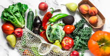 Food Background Banner. Seasonal Vegetables On A Marble Background - Kale Cabbage, Zucchini, Eggplant, Pepper, Cauliflower, Tomatoes, Pumpkin And Pears, Apples, Peaches. Top View, Flat Lay