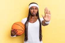 Looking Serious, Stern, Displeased And Angry Showing Open Palm Making Stop Gesture. Basket Concept