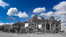 Deep Blue Sky Over A Colorless Stone Building Ruin