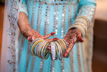 Indian Bride's Wearing Her Wedding Bangles Hands Close Up