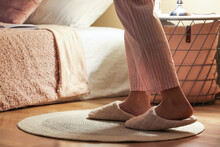 Young Woman Wearing Soft Slippers At Home