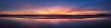 Panorama Sunset Ocean Beach Of Spain City Tarifa Andalusia. Atlantic Ocean Waves Background Bright Magic Sunset Sky
