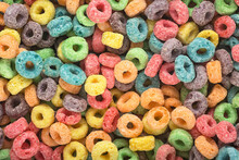 Background Of Round Colorful Cereal. Colorful Breakfast Food. Colorful Cereal Loop Rings.