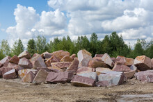 Different Blocks Of Red Granite With Flat And Torn Edges