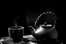 A Cups Of Tea With Teapot On Wooden Table And Dark Background, Black And White Picture