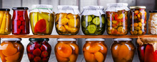 Jars With Variety Of Marinated Vegetables And Fruits