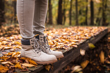Leather Hiking Boot On Trail In Autumn Forest