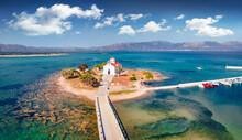 View From Flying Drone Of Saint Spiridon Church In Elafonisos Port. Incredible Morning Seascape Of Mediterranean Sea. Spectacular Outdoor Scene Of Elafonisos Island, Greece, Europe.