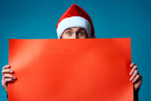 Emotional Man In A Santa Hat Holding A Banner Holiday Blue Background