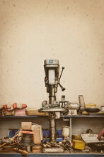 Messy Old Workshop Bench With Press Drill And Tools