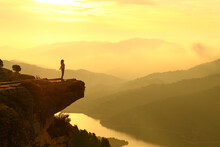 Woman Breathing In The Top Of A Cliff At Sunrise In The Mountain