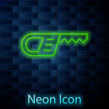 Glowing Neon Line Reciprocating Saw And Saw Blade Icon Isolated On Brick Wall Background. Vector