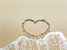 The Heart In The Sand Is Washed Away By The Sea Wave. Outgoing Love Concept