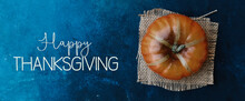Top View Of Pumpkin On Burlap With Happy Thanksgiving Blue Texture Background.