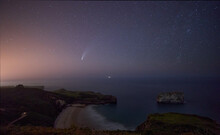 Comet NEOWISE Streaking Through The Sky Above The Ocean From The Cantabrian Sea.