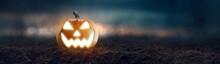 Jack O 'Lantern With Creepy Glowing Eyes On Halloween Night