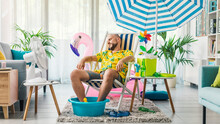 Man Having A Staycation And Resting On A Deckchair At Home