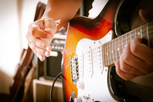 Guitar Music Band. Cropped Image Of Electric Guitar Player. Hands Playing Guitar Electric, Close Up