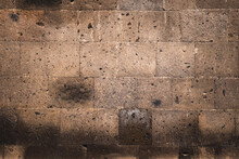 Background In The Form Of A Dark Stone Masonry In The Wall Of An Ancient Church Or House. The Texture Of A Speckled Sandstone