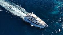 Aerial Drone Photo Of Luxury Yacht Cruising In Deep Blue Sea Near Island Of Mykonos, Cyclades, Greece