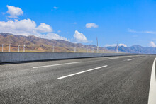 Highway Ground And Mountain Natural Scenery Under Blue Sky.Landscape And Highway.Outdoor Road Background.