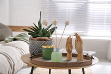 Wooden Tray With Air Reed Freshener, Plant And Mannequin Hands On Table In Living Room