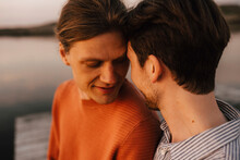 Gay Couple Doing Romance At Lakeshore