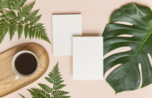 Styled Summer Wedding Mockup. Blank Greeting And Invitation Card. Green Tropical Leaves With Invitation Card On Table.