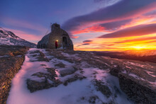 Aged Stone House Placed On Top Of Under Colorful Sky At Sunrise
