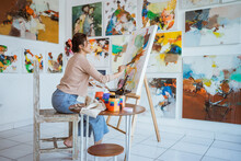 Asian Female Artist Painting On Canvas Doing Some Art Projects On Her Studio Workshop