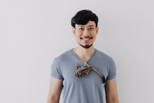 Happy Asian Man With His Shy Sugar Glider Climbing On His Body.