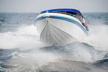 Speed Boat Sailing With Choppy Sea