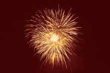 Yellow Fireworks Against Red Background