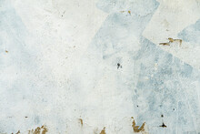Rough Plastered Concrete Wall With Cracks. Dirty Damaged Colorful Texture, Peeling Plaster. Vintage Background