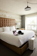 Luxury Hotel Room With Laptop And Suitcase