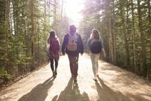 Friends Walking Through Forest