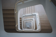 High Angle Shot Of A Square Spiral Staircase On A Building