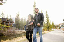 Couple Walking Along Path In Resort