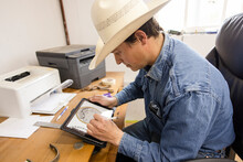 Male Farmer Designing Logo On Digital Tablet In Office