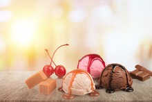 Set Of Various Colorful Ice Cream Scoops With Different Flavors And Fresh Ingredients