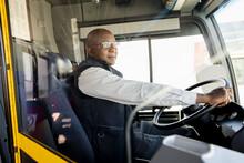 Male Bus Driver Driving Public Transit Bus