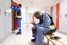 Male Worker Taking A Break In Maintenance Facility